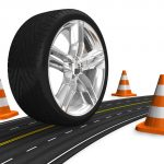 Automotive concept: car wheel on the road